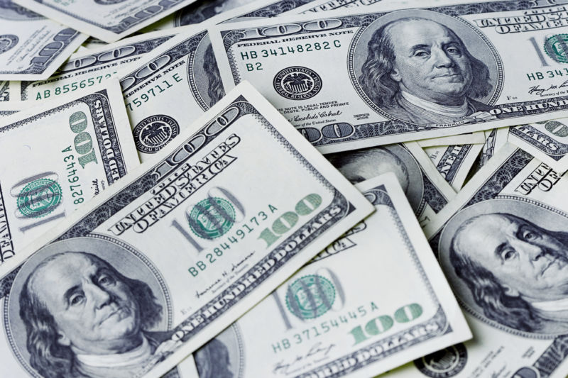 Pile of US one hundred dollar bills