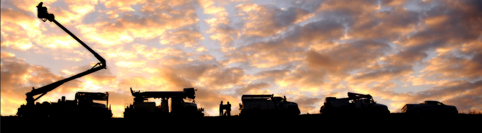 Trucks at sunset