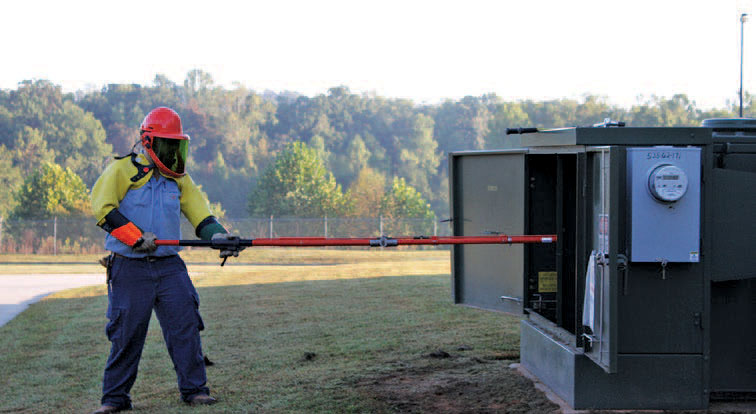 utility works uses hot stock to work with pad mounted transformer